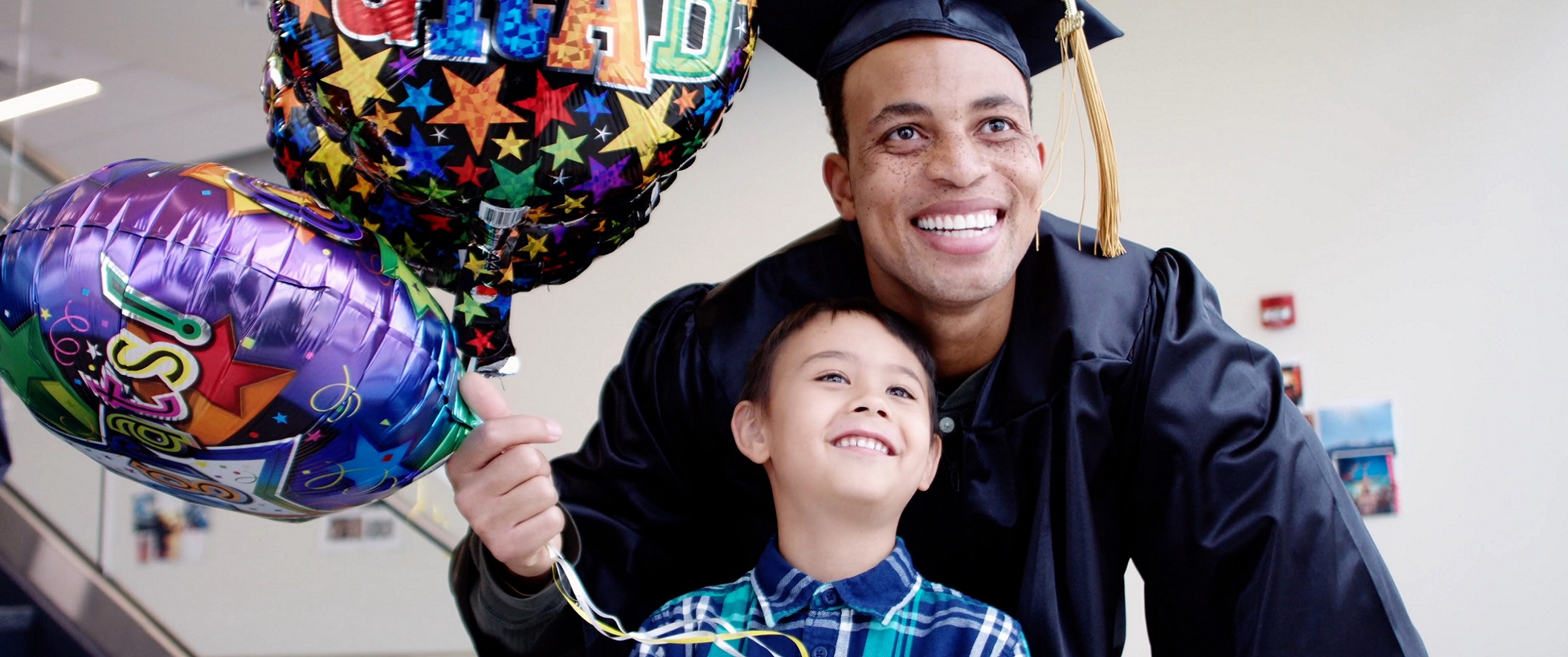 graduate dad  with son